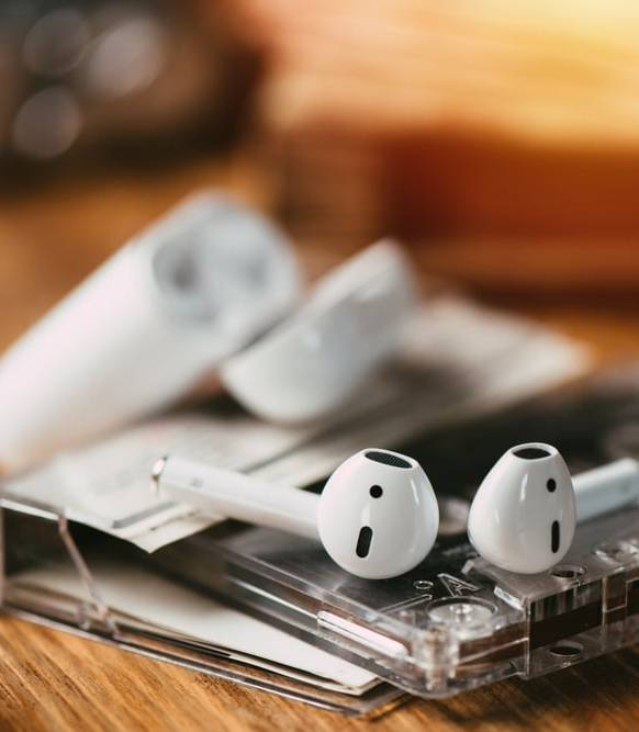 earbuds-on-top-of-a-cassette-tape