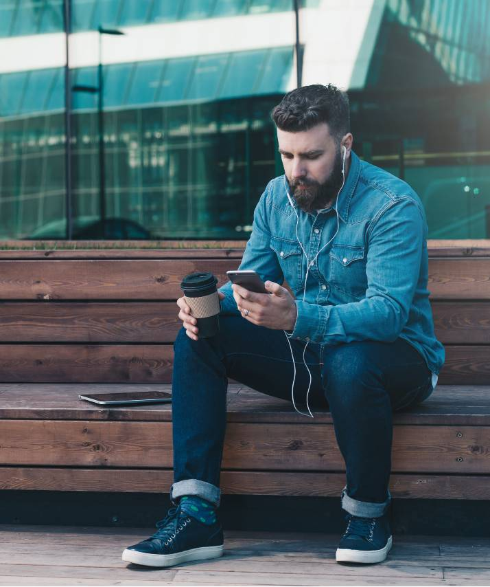 male reading email marketing message on his phone